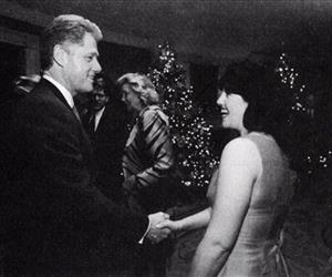 In this Dec. 16, 1996 White House photo, President Clinton and Monica Lewinsky shake hands at a Christmas party.