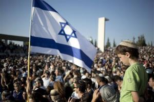 Family and friends of the three murdered Israeli teenagers mourn during their funeral in Modiin, Israel yesterday.