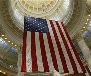 An American flag hangs from the ceiling of the rotunda in the Idaho Capitol in Boise, Idaho, on Sunday, June 29, 2014.