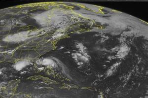 This NOAA satellite image taken Wednesday, July 02, 2014 at 1:45pm EDT shows a dense swirl of clouds off the Florida Atlantic Coast associated with Tropical Storm Arthur.