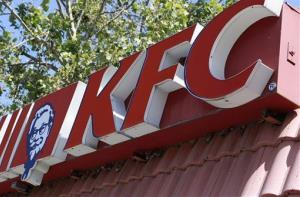 In this photograph taken July 13, 2010, the Kentucky Fried Chicken trademark logo is posted on a Mountain View, Calif., restaurant.