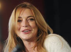 In this Jan. 20, 2014 file photo, actress Lindsay Lohan addresses reporters during a news conference at the 2014 Sundance Film Festival in Park City, Utah.