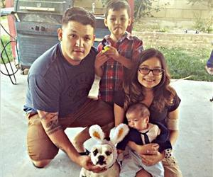 Yesenia Ruiz-Rojo with her husband, stepson and baby Luke this Easter at her family's home in California.