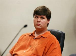Justin Ross Harris, the father of a toddler who died after police say he was left in a hot car for about seven hours, sits for his bond hearing in Cobb County Magistrate Court, Thursday, July 3, 2014, in Marietta, Ga.