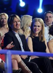 Keith Urban, left, and Nicole Kidman appear in the audience at the 2013 CMT Music Awards at Bridgestone Arena on Wednesday, June 5, 2013, in Nashville, Tenn.
