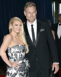 In this May 3, 2014, file photo, Jessica Simpson and Eric Johnson attend the White House Correspondents' Association Dinner.