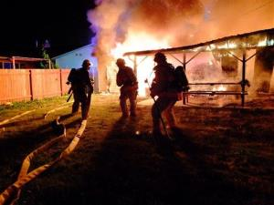 Firefighters from Rockwood Fire Station 31 and Gresham Fire battle a 4th of July house fire in Portland, Oregon