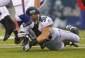 On Dec. 2, 2012, Jacksonville Jaguars' Russell Allen (50) tries a tackle at an NFL game in Orchard Park, NY. Allen is retiring after suffering a concussion and a stroke in a game last December.