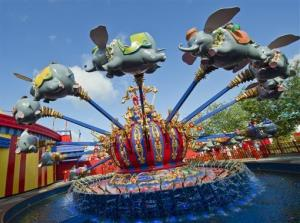 In this May 12, 2012 photo released by Disney theme parks, people ride the Dumbo attraction in the new Storybook Circus area of Fantasyland at Magic Kingdom Park in Lake Buena Vista, Fla.