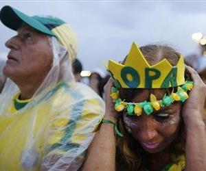 Brazil soccer fans react as they watch their team play Germany.