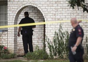 Law enforcement officers investigate the scene of a shooting in Spring, Texas.