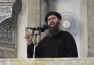 This image made from video posted on a militant website Saturday, July 5, 2014, purports to show the leader of the Islamic State group, Abu Bakr al-Baghdadi, delivering a sermon at a mosque in Iraq.