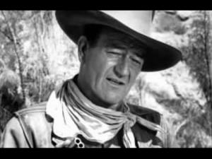 John Wayne plays government agent Saunders in Riders of Destiny.