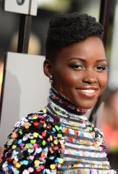 Lupita Nyong'o arrives at the MTV Movie Awards on Sunday, April 13, 2014, at Nokia Theatre in Los Angeles.
