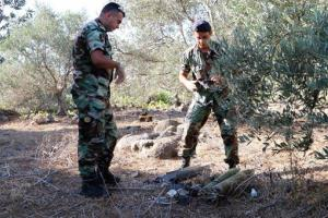 Lebanese army experts dismantle two rockets that were found ready to fire into northern Israel, in the southern Lebanese village of Al-Mari, Lebanon today.
