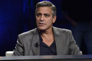 This Sunday, Feb. 9, 2014 file photo shows American actor George Clooney interviewed by Fabio Fazio during the Italian State RAI TV program Che Tempo che Fa, in Milan, Italy.