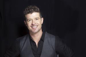 This Aug. 1, 2013 file photo shows R&B singer-songwriter Robin Thicke in New York.