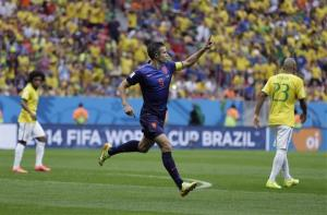 Netherlands' Robin van Persie celebrates after scoring his team's first goal in Brasilia, Brazil, Saturday, July 12, 2014.
