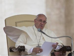 Pope Francis reads a speech during a  weekly general audience in St. Peter's Square at the Vatican.