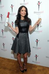 Bethenny Frankel raises her glass of new Skinnygirl Prosecco during a recent happy hour event for Skinnygirl Cocktails' newest wine offerings, Thursday, Nov. 7, 2013, in New York.?