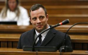 Oscar Pistorius attends court at his murder trial for the shooting death of his girlfriend Reeva Steenkamp on St. Valentine's Day 2013 in Pretoria, South Africa, Tuesday, July 8, 2014. Pistroius' lawyer Barry Roux says he has closed his case, and the judge says final arguments will be held in...