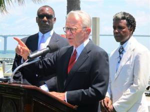 Mayor Joseph P. Riley Jr., center, announces that a $75 million International African American Museum will be built at the site of a wharf in Charleston.