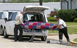 Authorities remove bodies from the Johnson Family Mortuary in east Fort Worth, Texas yesterday.