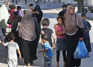 A girl cries as Palestinians flee their homes in the Shajaiyeh neighborhood of Gaza City, after Israel had airdropped leaflets warning people to leave the area on July 16, 2014.