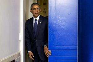 President Obama enters the briefing room to speak about the sanctions today.