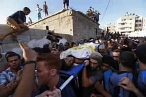 Mourners carry the bodies of one of four boys killed in an Israeli strike yesterday.