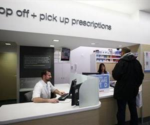 In this Wednesday, May 15, 2013, file photo, a pharmacist works at his desk located next to the prescription pick up counter in New York.
