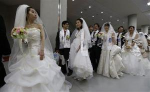 Couples from around the world arrive for their mass wedding ceremony in Gapyeong, South Korea, Feb. 17, 2013.