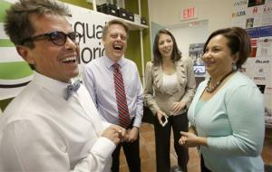 Jorge Isaias Diaz and partner Don Price Johnston laugh with Catherina Pareto and partner Karla Arguello on Jan. 21, 2014, in Miami Beach, Fla.