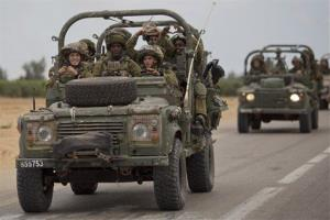 Israeli soldiers ride near the Israel-Gaza Border, Thursday.