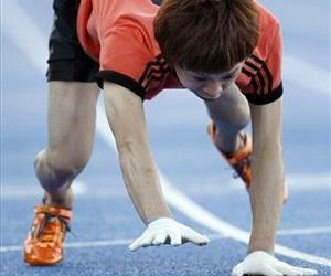 In this file photo, Kenichi Ito is on his way to setting the Guinness World Record for the fastest time to run 100 meters on all fours.