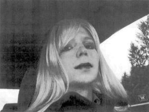 In this photo provided by the US Army, Pfc. Chelsea Manning poses  wearing a wig and lipstick.