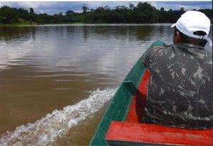 This 2013 photo shows Amazon jungle guide Shane Zammette surveying the shorelines on the Amazon River about 100 miles from Manaus, Brazil.