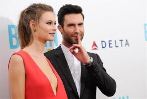 Adam Levine and fiancee Behati Prinsloo attend premiere of Begin Again at the SVA Theatre on Wednesday, June 25, 2014 in New York.