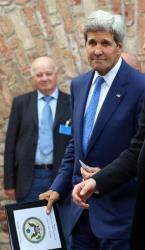 John Kerry leaves the hotel where closed-door nuclear talks on Iran take place in Vienna, Austria, Monday, July 14, 2014.