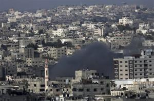 Smoke rises after an Israeli missile strike in Gaza City, in the northern Gaza Strip, Sunday, July 20, 2014.