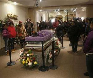 In this Feb. 8, 2013 file photo, mourners view the remains of 15-year-old Hadiya Pendleton at the Calahan Funeral Home in Chicago.