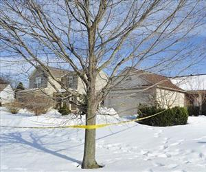 In this March 7, 2014 file photo police tape surrounds a home in Pontiac, Mich., where the mummified body of a woman was found in the garage.