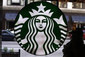In this May 31, 2014 photo, the Starbucks logo is seen at one of the company's coffee shops in downtown Chicago.