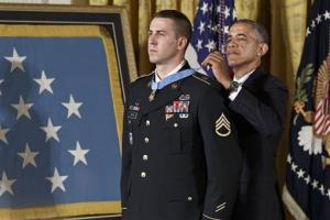 President Barack Obama bestows the Medal of Honor to Ryan M. Pitts, 28, of Nashua, NH, in the East Room of the White House in Washington, Monday, July 21, 2014.