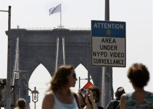 A white flag flies atop the west tower of New York's Brooklyn Bridge.