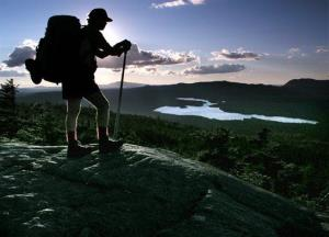 A hiker pauses on the Appalachian Trail in Maine.