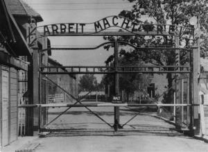 Writing over the main gate of the Nazi concentration camp Auschwitz I in Poland in 1945 reads: Arbeit macht frei (Work makes free or work liberates.