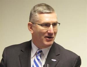 Sen. John Walsh, a Montana Democrat, speaks to reporters in Helena, Mont.