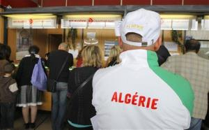 Stranded passengers wait for a flight at Orly airport near Paris in this July 13, 2011, file photo during an Air Algerie strike.