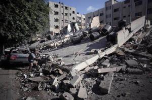 A Palestinian man inspects a destroyed house this morning following an overnight Israeli strike in Gaza City.